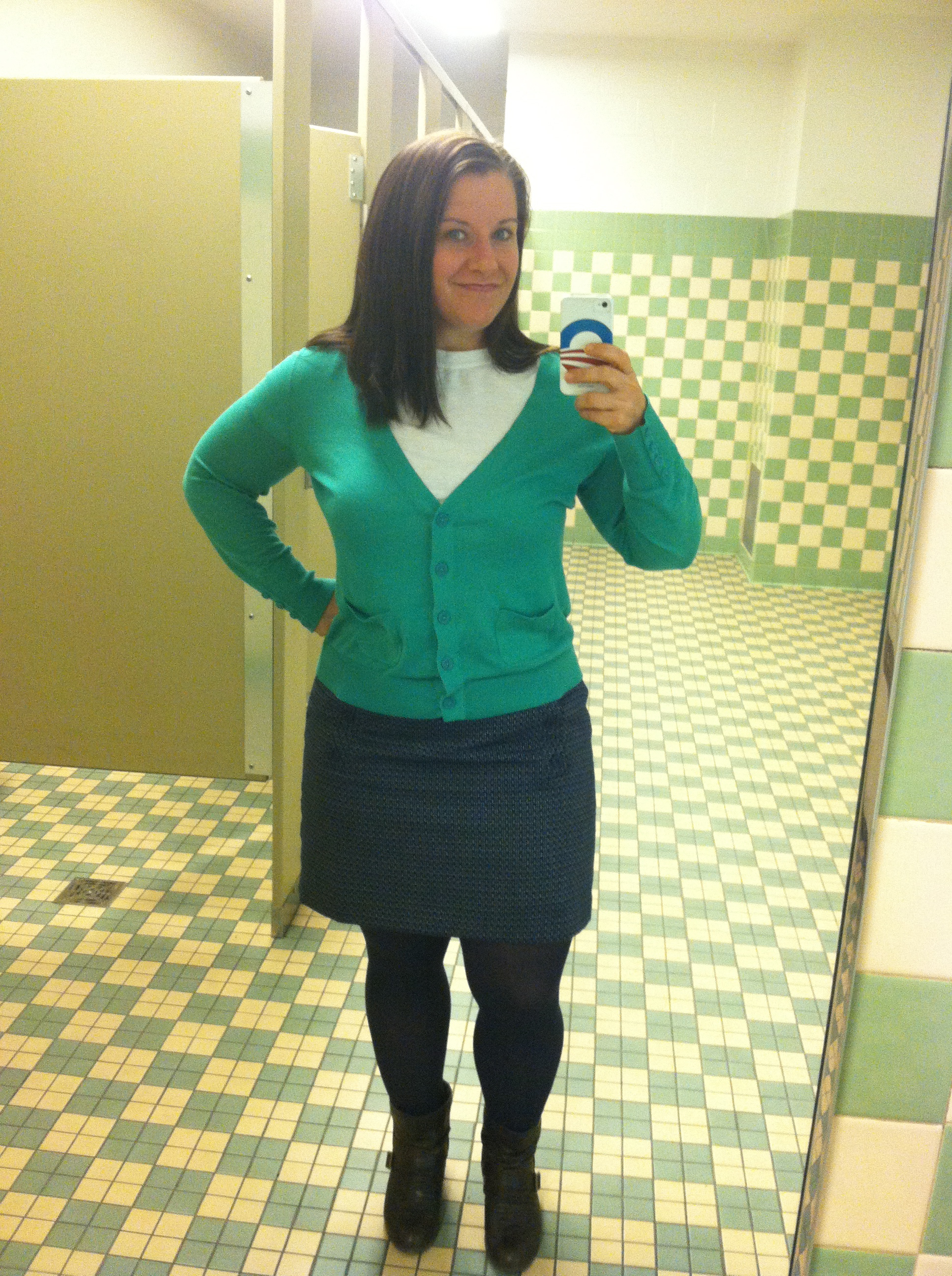 Navy textured skirt with buttons, white t-shirt, same turquoise cardigan as above (I'm MIXING, I'm MATCHING), navy tights. Also, short boots.